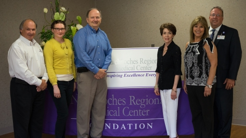 The City of Natchitoches will receive a $11,678.00 grant from the NRMC Foundation, which will be awarded at the Foundation's upcoming Gala, to be held Saturday, May 16 from 7:30 PM – 12 midnight at the Natchitoches Events Center. The grant will go to purchase exercise and health equipment for exercise stations. Shown L-R: Randy LaCaze, Dallas Russell and Mayor Lee Posey, City of Natchitoches; Sharon Gahagan, NRMC Foundation Board; Cathy Jacobs, NRMC Physician & Community Relations Director; Kirk Soileau, NRMC CEO