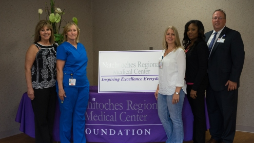 Heather Roberts, Becky Collins, and LaQuita Weston represent more than 120 nursing students, who have received scholarships from the NRMC Foundation since 1987.